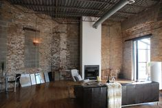 Love industrial spaces as long as they feel homey. Brick walls, exposed ductwork, fireplace...
