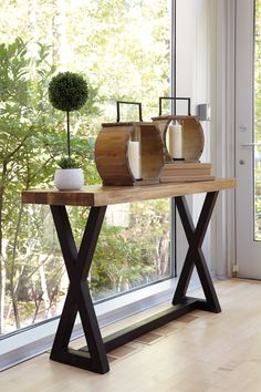 this simple trestle style table is NEW & we love it. the black finish with the natural wood finish is a beautiful combo! #sofatable #consoletable #trestle #furniture