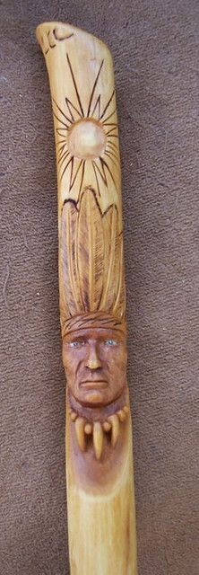 Hand carved walking stick. Indian stick with rattlesnake and bear.  Sun, moon, wind and water elements carved on top.  Bear claw and bead necklace.