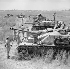British troops inspect line up of captured German and Italian armoured fighting vehicles Italy June 1944