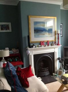 Oval Room Blue. combined with Wimbourne White on the gloss work. living room is south facing and the colours change throughout the day, due to the rich colour.I have accented with red and cream and love the look of the living room. The room is relatively small 12ft by 12ft and I thought the colour would be too dark, but it is not.