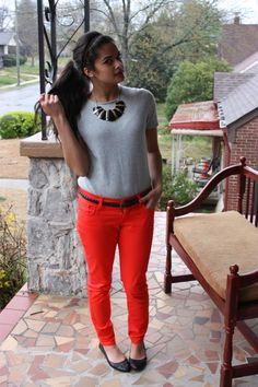gray sweater top, red pants, statement necklace
