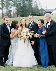 Brittany and Alex posed with their parents, who have been friends since before the two started dating. Both couples have been married for over 32 years, and Brittany's mother and father offered a piece of advice for the newlyweds: Be patient and enjoy life together! #motherofthebridedress #weddingattire #weddingphotoideas #weddinginspo | Martha Stewart Weddings - One Couple's Elegant Lakeside Wedding in South Carolina