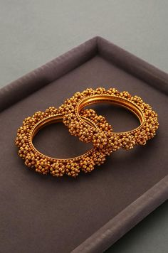 Ginisha Temple Work Floral Emboss Bangles - Set of 2 – Paisley Pop Shop Antique Jewellery Designs, Fancy Jewellery, Antique Jewelry, Gold Bangles Design, Gold Jewellery Design, Bridal Bangles, Bridal Jewelry, Ruby Bangles, Bridal Shoes