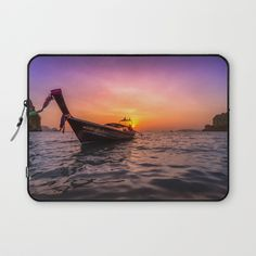"Longtail Sunset Laptop Sleeve. More than just premium protection, our form-fitting Laptop Sleeves make a statement, featuring bold artwork, rich colors and creative patterns. All laptop cases display double-sided prints on durable polyester, with a soft interior to prevent scratches. - Available in 13"" and 15"" sizes. #sunset #beach #paradise #tropical #summer #longtail #ocean #sea #adventure #travel #wanderlust #thailand #landscape #laptop #sleeve"