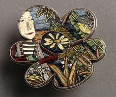 Polymer clay micromosaic pendant by Cynthia Toops; metalwork by Chuck Domitrovich.