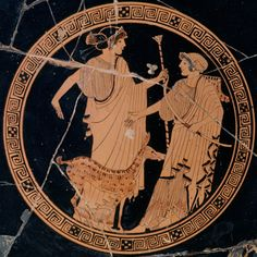 The god Apollo with his sister Artemis. The painting is inside a bowl made about 490 BC