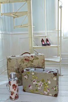Give an old case a fresh start. MODGE PODGE FABRIC onto suitcases . ( your choice of fabric... shabby chic ... modern... stripes,  velvet .... hmmm .  Use the suitcases to store art supplies, crafts supplies, toys, etc... Click to see