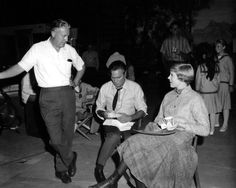 Director Robert Wise with Christopher Plummer and Julie Andrews on the set of The Sound of Music, 1965.