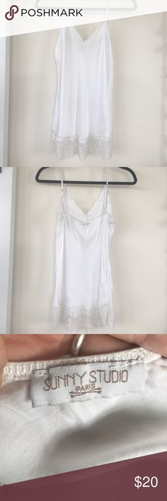 LACE LINGERIE CAMISOLE Beautiful white camisole with lace trim, and adjustable straps, Great piece to dress up or down, for a night out, and afternoon lunch… Or lounging in bed!! Made in Italy, from a Paris company!!! Has one tiny spot on the front as seen in the last photo, used only for photo shoot's, in great condition!      ‼️SORRY NO TRADES ‼️PRICE FIRM UNLESS BUNDLED  ‼️ITEMS SHIPPED NEXT BUSINESS DAY Sunny Studio Intimates & Sleepwear