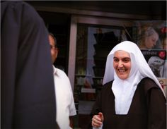 A smiling nun on the street of Rome, near the Vatican