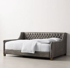 RH TEEN's Devyn Tufted Leather Daybed - Weathered Oak:Generous tufting on the back and sides of our platform-style daybed offers all the comfort of a sofa, making this an ideal spot for lounging, reading or indulging in some quiet time.
