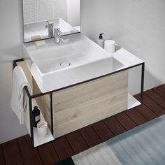 Fits perfectly into small urban bathrooms: the Junit collection by Burgbad playfully combines ceramic washbasins with open and closed furniture elements. Design by nexus product design.