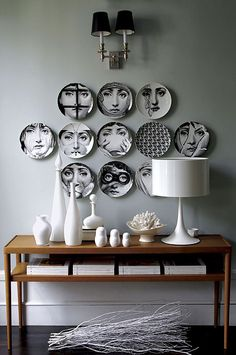 Fornasetti dishes on the walls! Don't they look fabulous?
