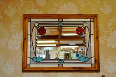 An ordinary mirror turned extraordinary, after some unique stain glass upcycling by an Emmaus Dover companion.