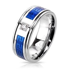 SS ring w/ Simltd. Diamond and blue IP key. Stainless Steel Duo Tone Blue IP Plated,   Round Simulated Diamond Centered Maze Inlay with a Comfort-Fit Band Ring.   Width 8MM Z2195SD268,  sizes 9-13,  please check availability, 7-10 s/h. Jewelry Rings