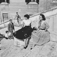 Two young women sitting on the Spanish Steps in Rome.– Photo, 1950's. © Jacques Rouchon / akg-images