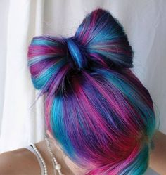 Cute pink, purple, and blue colored hair in a bow