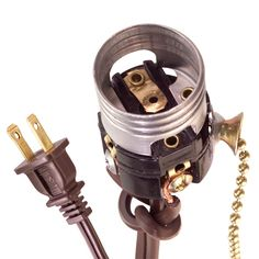 Correctly connect hot and neutral wires when you replace a lamp switch and socket to keep your lamp safe. Even an inexpensive plug and cord has a marked neutral wire.