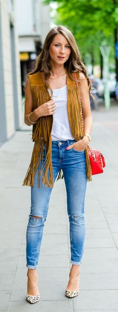 Pair your fringe over a basic white top, skinny denim and some fabulous platforms or heels for a chic look that's sophisticated and can translate from work to play! Where would you wear this look? How would you style a fringe vest?