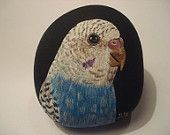 Blue Budgie hand painted on a rock.