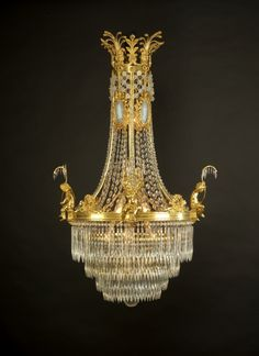 An Important Antique Louis XVI Style Cut Glass and Gilt-Bronze Mounted Chandelier with Wedgwood Style Porcelain Plaques. French,  Circa 1900.