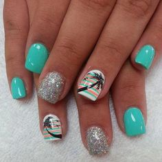 Celebrate the summer with this fun looking nail art design coated in white sea green and salmon hues; the design depicts a coconut tree topping a combination of melon and sea green vertical lines. There are also silver sparkles added to make the nail design stand out even more.