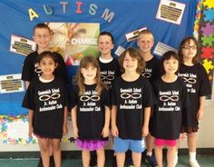 Greenwich Twp AA club 2012, posing for a photo in front of their Autism Awareness Month Bulletin Board!