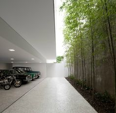 Garage with small, green courtyard for daylight by Issay Weinfeld. Photo by Fernando Guerra.