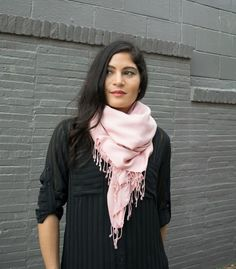 This lightweight pink scarf was handcrafted by a weaver in Cambodia. The silky texture of the cotton gives your casual look a touch of luxury.