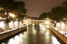 Paris at night along the Seine River near Notre Dame Cathedral