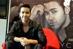 Prince Royce is all smiles as he sits on his red throne at a press conference for his new album, Soy El Mismo, on Oct. 14 in San Juan, Puerto Rico