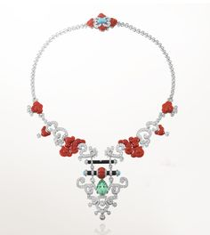 "This is a contemporary piece of jewelry made by Van Cleef & Arpels in the Art Deco style. It is from their Palais de la Chance collection. ""Bois Céleste necklace, white gold, diamonds, coral, letter wood, turquoise, one 9.51-carat pear-shaped grossular garnet."" Source: http://www.vancleefarpels.com/us/en/line/122/palais-de-la-chance"