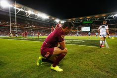 Cooper Cronk Photos Photos - BRISBANE, AUSTRALIA:  Cooper Cronk of the Maroons looks dejected during game one of the State Of Origin series between the Queensland Maroons and the New South Wales Blues at Suncorp Stadium on May 31, 2017 in Brisbane, Australia. - State Of Origin I - QLD v NSW