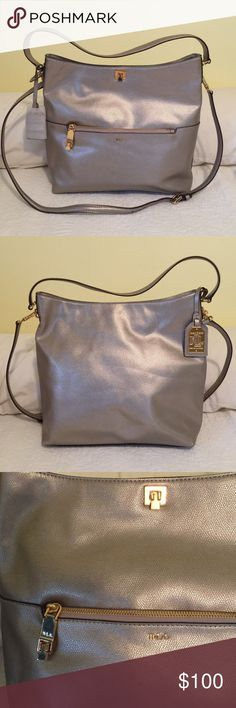 Ralph Lauren NWOT bucket hobo bag Ralph Lauren NWOT silver mink bucket hobo handbag with detachable shoulder strap.  Light khaki lining from the Whitby group.  Zippered front outer pocket is good for keys and keeping things handy.  Inside has one zippered pocket and one snap pocket with two slip pockets;  plenty of room for everything;   Front zippered pocket has additional closure if needed and top also has a closure. Ralph Lauren Bags Hobos