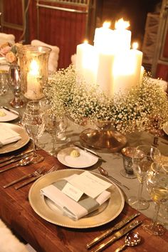 Great idea...Cake stand with candles... Love the baby's breath
