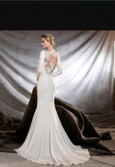 This simply elegant style is straight out of a dream...Available at Spotlight Formal Wear! #SpotlightBridal