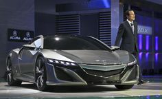 Takanobu Ito, President and CEO of Honda, introduces the Acura NSX concept at the North American International Auto Show.