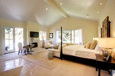 Vaulted ceiling....love the pale yellow walls + windows + floor