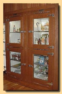 Antique wood ice box/refrigerator case.  Beautiful! Luke and I want to one day have this as part of our bar set-up at home:)