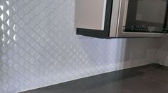 This Image Features White Porcelain Diamond Mosaic In A Kitchen Backsplash.