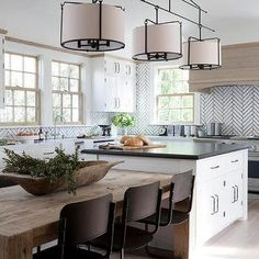 Just Pinned to Cuisines modernes: A three light drum pendant hangs over a white kitchen island topped with black quartz and a reclaimed wood dining table lined with vintage black dining chairs. Kitchen Island And Table Combo, Farmhouse Kitchen Island, White Kitchen Island, Kitchen Island With Seating, Kitchen Islands, Kitchen Island With Table Attached, Islands With Seating, Country Kitchen, Farmhouse Table