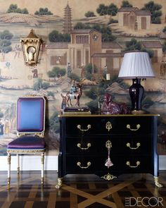The chest came from a Paris flea market, and the lamp was found at Christie's; the sconce is antique, and the walls are covered in a Gracie wallpaper.