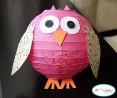 Love this!  Inexpensive paper lanterns with a little construction paper or scrap book paper become owls to hang at baby shower!  Sooo doing this!