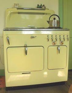 Retro kitchen stove in pale yellow.