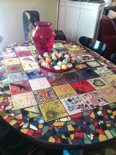 mosaic table by Bren Mason - Since 1996, twice a year, our family goes to the local DIY ceramics shop to paint tiles & Easter eggs.
