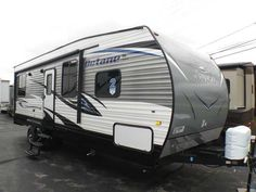 """2016 New Jayco Octane Super Lite 273 Toy Hauler in Ohio OH.Recreational Vehicle, rv, MSRP: $30,330! *** Front Bedroom, Back Garage: Air, Power Awning, Jacks, Aluminum Rims, Garage w/ Fold Away Sofa and Table w/ 2 Chairs, Microwave/Convection Oven, Cook-Top, Refrigerator, Furnace, 2 Year Warranty *** Options Included in this Price:Mojave Interior *** Table w/ 2 Chairs - Doorside *** Retractable Screen Wall *** Octane Super Lite Package w/ 15K A/C: 102"""" Wide Body Construction, Aluminum Rims…"""