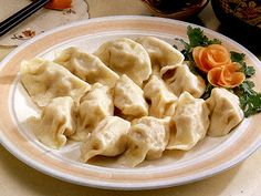 Pelmeni (пельмени in Russian, singular pelmen, пельмень; пяльмені in Belarusian) are a traditional Eastern European (mainly Russian) dish usually made with minced meat filling, wrapped in thin dough (made out of flour and eggs, sometimes with milk or water added).