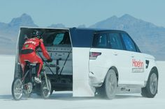 Denise Mueller paced by Shea Holbrook in Range Rover