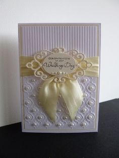 Stamps: SU Occasional Quotes   Paper: SU Whisper white, very vanilla   Ink: Stazon black   Accessories: SB Fancy tag die, Couture creations EF, oval punch, May Arts cream silk ribbon, pearls, dimentionals